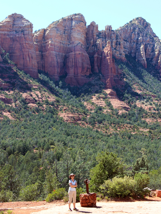 Landscape, A landscape view of a hiker on Soldier Pass Hiking Trail in Sedona, Arizona, with red rock spires in the background. Moderate Hikes, Sedona Area Hikes. View, Hiker, Soldier Pass Hiking Trail, Sedona, Arizona, Red Rock, Spires, Moderate Hikes, Sedona Area Hikes