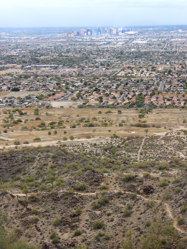 A panoramic view over downtown Phoenix, and the Holbert Hiking Trail to Dobbins Lookout, in South Mountain Park, Phoenix, Arizona. Moderate Hiking Trails, Phoenix Area Hiking Trails. Copyright azutopia.com. No use without permission.