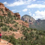 Hiker; Mescal Hiking Trail; Sedona; Arizona; Red Rocks; Cliffs; Mesa; Bluffs; Easy Hiking Trails; Family Friendly Hiking Trails; Pet Friendly Hiking Trails. Copyright azutopia.com. No use without permission.