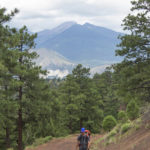 Hiker; Backpacker; O'Leary Lookout Hiking Trail; Flagstaff; Arizona; Moderate Hiking Trails; Views; Humphreys Mountain; Dog Friendly Hiking Trails. Copyright azutopia.com. No use without permission.