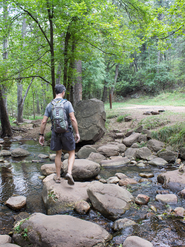 Hiker; Christopher Creek; Stream; Babbling Brook; Rocks; Trees; Grass; Forest; Greenery; See Canyon; See Spring Hiking Trail; Payson; Arizona; Mogollon Rim; Easy Hiking Trails; Family Friendly Hiking Trails; Pet Friendly HIking Trails; Central Arizona; Copyright azutopia.com; No use without permission.
