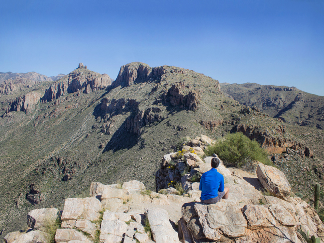 Hiker; Sitting on Ridge; Peak; Blacketts Ridge Hiking Trail; Sabino Canyon; Santa Catalina Mountains; Mountain View; Tucson; Arizona; Difficult Hiking Trails; Tucson Area Hiking Trails; Copyright azutopia.com; No use without permission.