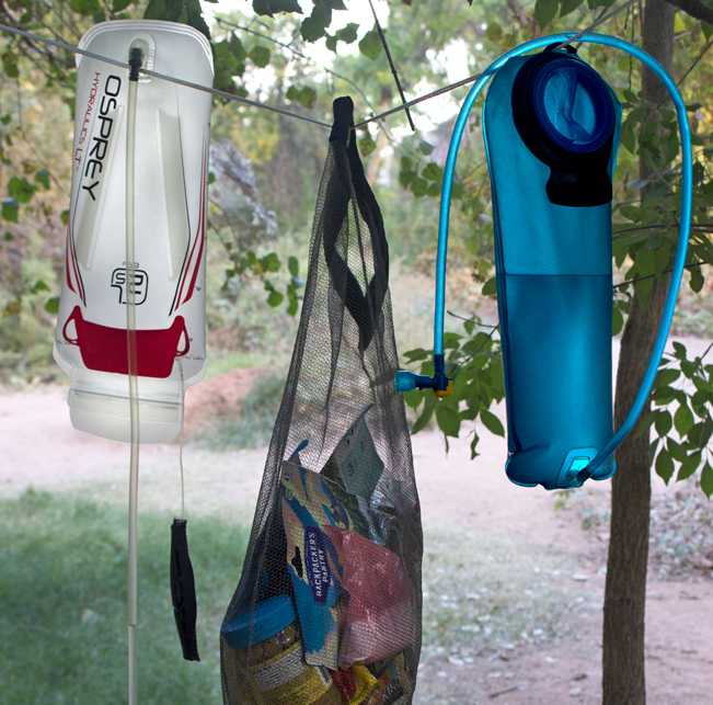 Water Bladders; Food Bag; Hanging on Guyline; Campsite; Havasu Campground; Havasu; Arizona; Grand Canyon. Copyright azutopia.com. No use without permission.