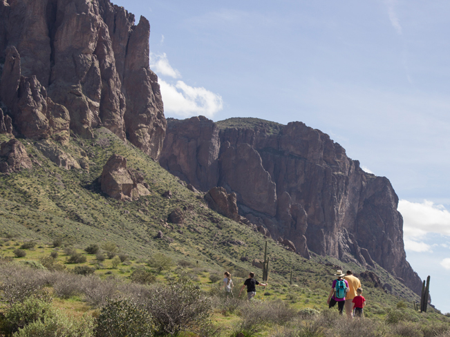 Family of Hikers; Treasure Trail Hiking Loop; Lost Dutchman State Park; Superstition Mountains; Arizona; Cliffs; Rock Formations; Brush and Saguaros; Copyright azutopia.com. No use without permission.
