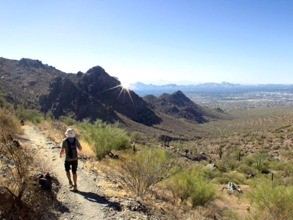 Hiker; Bell Pass Hiking Trail; Phoenix Area; Arizona; McDowell Mountains; Pass; Mountaintop; Scottsdale; Mountains; Saquaros; Rocky Outcropping; View; Camelback Mountain; Piestewa Peak; Difficult Hiking Trails; Copyright azutopia.com. No use without permission.