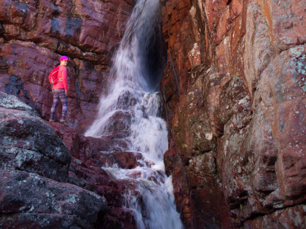 Hiker; Waterfall; Spring Snowmelt; Red Cliffs; Rocks; Matzatzal Mountains; Barnhardt Hiking Trail; Payson; Arizona; Difficult Hiking Trails. Copyright azutopia.com. No use without permission.