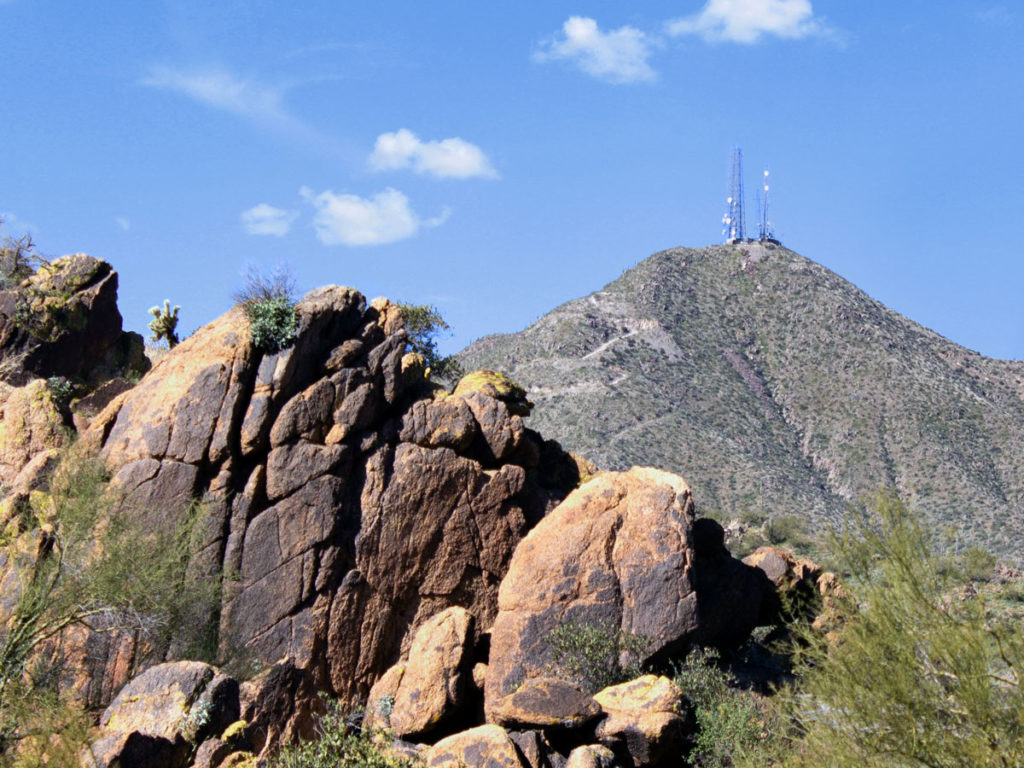 Landscape view of Thompson Peak with Satellites towers on top; Blue sky; Large boulders in foreground; from Dixie Mine Hiking Trail; to Thompson Peak Hiking Trail; McDowell Mountains; Phoenix Area Hikes; Difficult Hikes; Fountain Hill; Arizona. Copyright azutopia.com. No use without permission.