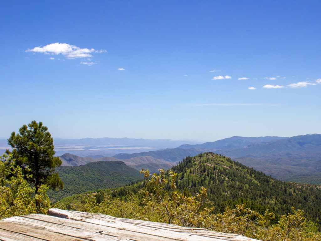 View of sky; mountains and valleys from platform ontop of Union Mountain; Prescott; Arizona; Dandrea and Yankee Doodle Hiking Trails; Moderate Hiking Trails; Central Arizona Hiking Trails. Copyright azutopia.com. No use without permission.
