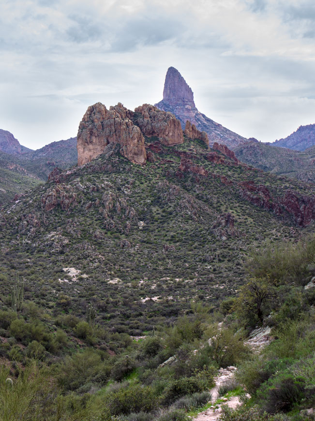 Landscape view, Superstition Mountains, Weavers Needle with red rock outcroppings, Palo Verde and Scrub in front, Black Mesa Hiking Trail Loop, Grand Enchantment Hiking Trail, Second Water Hiking Trail, Apache Junction, Arizona, Copyright azutopia.com, No use without permission