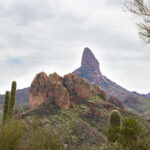 Landscape view, Superstition Mountains, Weavers Needle with red rock outcroppings and Saguaros in front, Black Mesa Hiking Trail Loop, Grand Enchantment Hiking Trail, Second Water Hiking Trail, Apache Junction, Arizona, Copyright azutopia.com, No use without permission