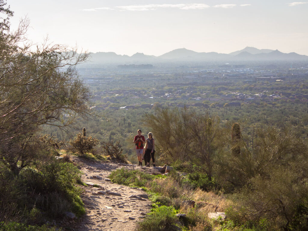 Hikers, Gateway Hiking Trail Loop, North side, Arizona, Scottsdale, Phoenix Area Hiking Trail, Moderate Hiking Trail, Dog Friendly Hiking Trail, McDowell Mountains, Scottsdale Skyline and White Mountains in distance, Saguaros, Copyright azutopia.com, No use without permission
